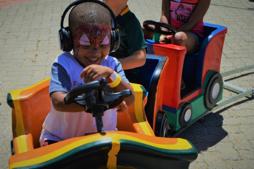 kiddie rides , silent disco , face painting , fun , event entertainment